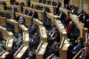 Jordanian lawmakers attend the second day of a heated…