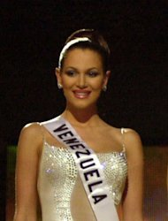 FILE - In this May 11, 2001 file photo, Miss Venezuela Eva Ekvall stands with other contestants, unseen, as they wait for the announcement of the winner of Miss Universe in Bayamon, Puerto Rico. Ekvall died on Saturday Dec. 17 of cancer in Houston at age 28. The Venezuelan television channel Globovision reports that Ekvall died on Saturday in a Houston hospital after a long struggle with breast cancer. At age 18, Ekvall was third runner-up in the Miss Universe pageant in Puerto Rico. She was a model, actress and television news anchor. (AP Photo/Tomas van Houtryve, File)