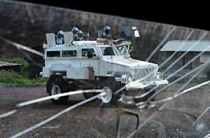 A FIB armoured vehicle of MONUSCO is pictured through…