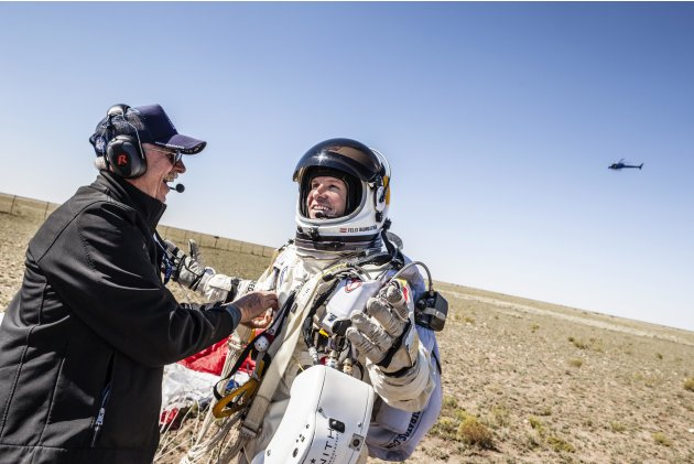 Handout photo of life support engineer Mike Todd of the U.S. and pilot Felix Baumgartner of Austria celebrating after Baumgartner successfully completed the final manned flight for Red Bull Stratos in