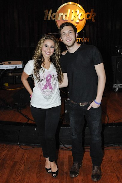 """Haley Reinhart, left, who placed third in the tenth season of """"American Idol"""" and """"American Idol"""" Season 11 winner Phillip Phillips, right,  kick off the Under 40 Music Marathon as part of Hard Rock's 12th Annual PINKTOBER breast cancer awareness campaign at Hard Rock Cafe, on Friday, Sept. 28, 2012 in Washington. (Invision for Hard Rock/AP Images)"""