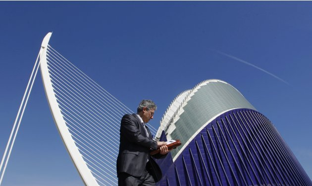 A pedestrian walks past the Agora building and the Azud D'or bridge at the City of Arts and Sciences, designed by architect Calatrava, in Valencia