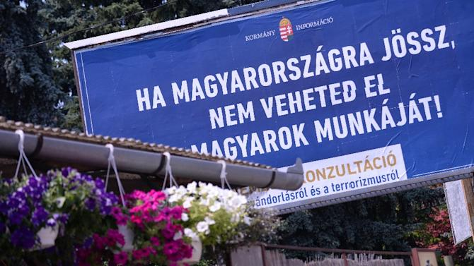 A billboard with a state-funded anti-immigration poster reads 'If you come to Hungary, do not take the Hungarians' jobs!' in the third district of Budapest on June 8, 2015