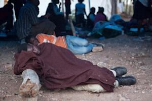 Zimbabwean nationals sleep in a tent at a support centre …
