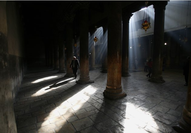 A file photo shows a man walking through the Church of Nativity in Bethlehem