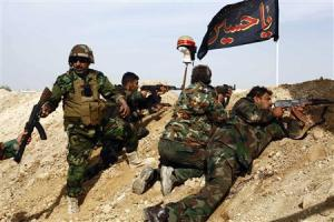 Shi'ite fighters, who are fighting alongside forces…