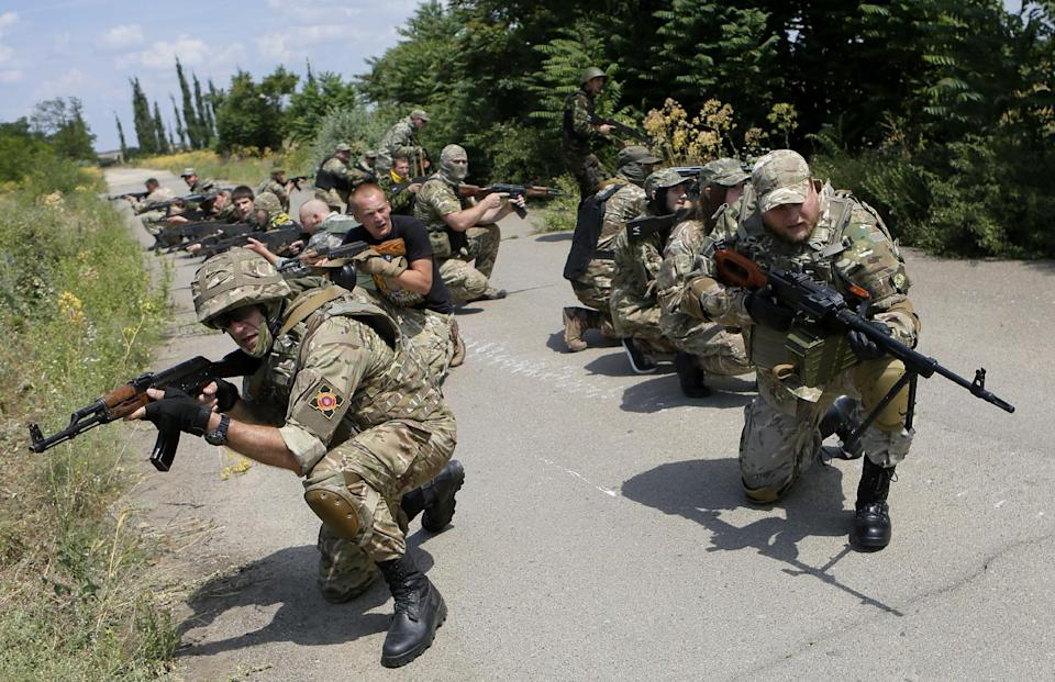 In this photo taken on Thursday, June  25, 2015, members of a self-defense unit carry out exercise drills in a location outside Odessa, Ukraine...