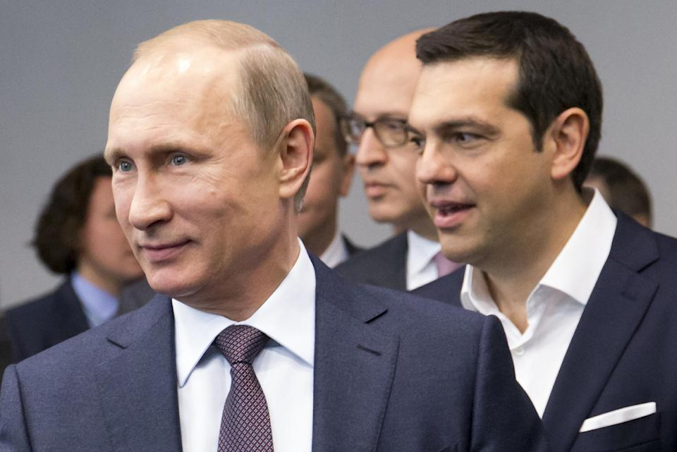 Russian President Vladimir Putin, foreground, and Greek Prime Minister, behind him, Alexis Tsipras arrive for their talks at the St. Petersburg...