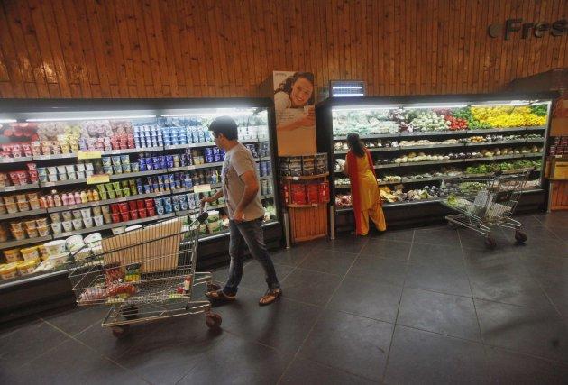 Customers shop inside a HyperCity supermarket in Mumbai