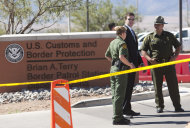Border Patrol Agents and Secretary of Homeland Security Janet Napolitano's security detail stand guard outside the Brian A. Terry Border Patrol Station outside in Bisbee, Ariz. on Friday, Oct. 5, 2012. A preliminary investigation has found friendly fire likely was to blame in the shootings of two border agents along the Arizona-Mexico border, the FBI said Friday. (AP Photo/The Arizona Republic, David Wallace) MARICOPA COUNTY OUT; MAGS OUT; NO SALES