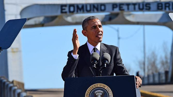 "President Barack Obama speaks near the Edmund Pettus Bridge, Saturday, March 7, 2015, in Selma, Ala. This weekend marks the 50th anniversary of ""Bloody Sunday,' a civil rights march in which protestors were beaten, trampled and tear-gassed by police at the Edmund Pettus Bridge, in Selma. (AP Photo/Bill Frakes)"