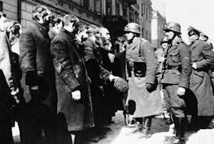 FILE - This 1943 file photo shows Nazi officers talking …