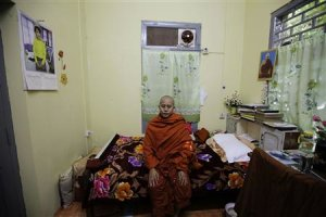 Wirathu, a Buddhist monk, poses for a photo in his…