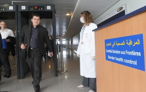 Passengers from Paris pass a health inspection point at the Mohamed V airport in Casablanca on May 7, 2009, after measures were put in place to control the threat of sine flu. A fisherman has died of swine flu in the Western Sahara region, where 11 others have been tested H1N1 positive, the Moroccan health ministry said on Sunday