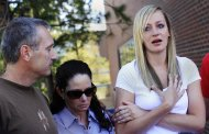 Amanda Lindgren (R), girlfriend of Alex Teves, speaks as Alex's parents, Tom Teves (L) and his wife Caren, listen during an interview after the preliminary hearing for Colorado shooting suspect James Eagan Holmes, at the Arapahoe County Courthouse in Centennial, Colorado July 23, 2012. Alex Teves was killed while protecting Lindgren during the shooting in a Colorado movie theater at the midnight screening of the new Batman movie early Friday.  REUTERS/Shannon Stapleton (UNITED STATES - Tags: DISASTER CRIME LAW)