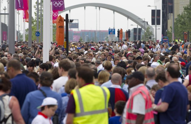 People queue to get into the Olympic Park for the opening ceremony of the 2012 Olympic Games in London