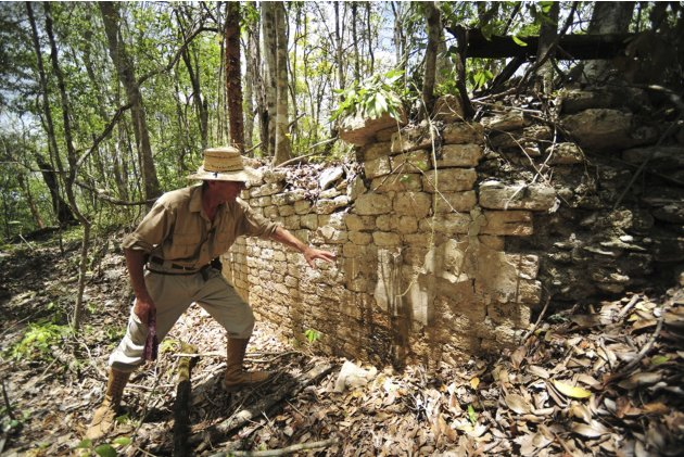 INAH handout photo shows an INAH worker showing the remains of a building at the newly discovered ancient Maya city Chactun in Yucatan peninsula