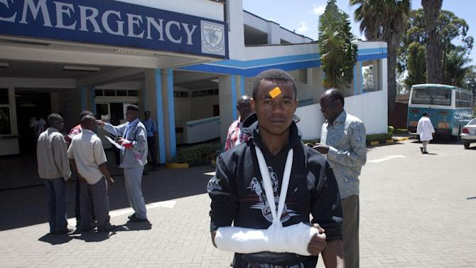 A university student with a broken arm in plaster leaves Kenyatta National Hospital, Sunday, April 12, 2015, in Nairobi, Kenya. One Kenyan student was killed and 141 injured in a stampede Sunday on the campus of the University of Nairobi when students mistook several accidental explosions for an extremist attack, according to an official. One male third-year student was killed in the crush of students, Peter Mbithi, Vice Chancellor of the University of Nairobi, told The Associated Press. The injured students have been taken to hospitals for treatment, he said. (AP Photo/Sayyid Azim)