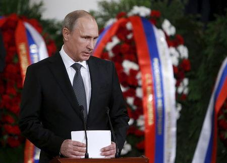 Russian President Putin attends a memorial service before the funeral of former Russian Prime Minister Primakov in Moscow