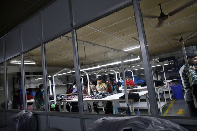 Employees work at the Estee garment factory in Tirupur