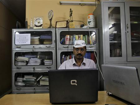 Arvind Kejriwal, a social activist and anti-corruption campaigner, works on his laptop after his interview with Reuters in Ghaziabad on the outskirts of New Delhi October 22, 2012. REUTERS/Mansi Thapliyal