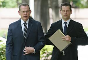 Former FBI agent Matthew Lowry (R) arrives for sentencing …