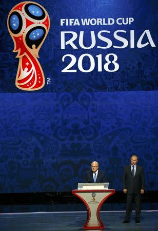 FIFA's President Blatter addresses next to Russia's President Putin during the preliminary draw for the 2018 FIFA World Cup at Konstantin Palace in St. Petersburg