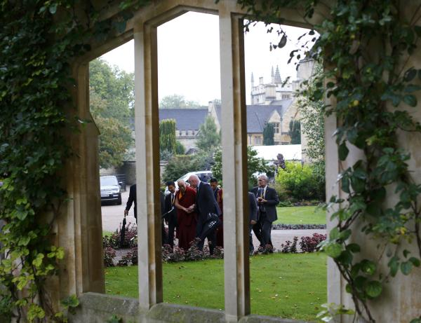 , the Dalai Lama arrives for a news conference at Magdalene College ...