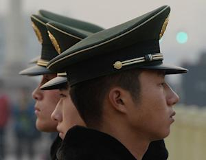 Chinese para-military police are seen standing guard …