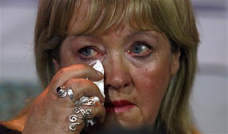 "Maureen Sullivan who worked in a ""Magdalene Laundry"", wipes a tear during a ""Magdalene Survivors Together"" news conference in Dublin February 5, 2013. REUTERS/Cathal McNaughton"