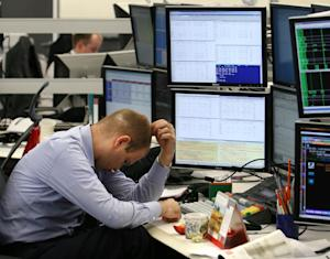 A Russian trader studies the markets at a investment …