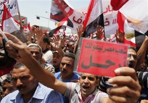 Protesters opposing Egyptian President Mursi shout …