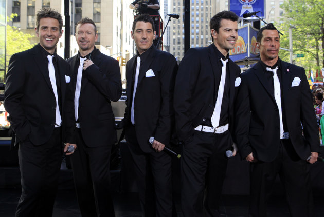 FILE - This May 8, 2009 file photo shows members of New Kids on the Block, from left, Joey McIntyre, Donnie Wahlberg, Jonathan Knight, Jordan Knight, and Danny Wood on the NBC 'Today' television program in New York. New Kids On the Block, 98 Degrees and Boyz II Men are teaming up for a summer tour. The groups announced 'The Package Tour' on Tuesday, Jan. 23, 2013, on the daytime program, 'The View.' (AP Photo/Richard Drew)