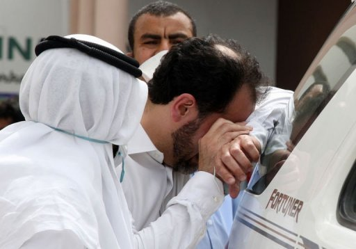 A father of one of the victims cries for the loss of his son outside Doha's Villaggio Mall