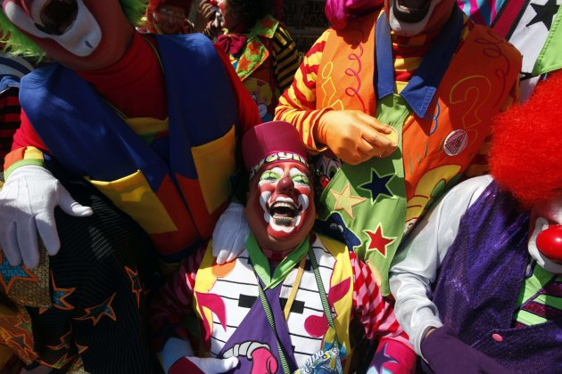 Clowns laugh for fifteen minutes as they rally for peace during the 17th Latin American clown convention or