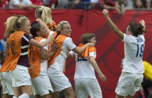 England players celebrate a 2-1 win over Canada during…
