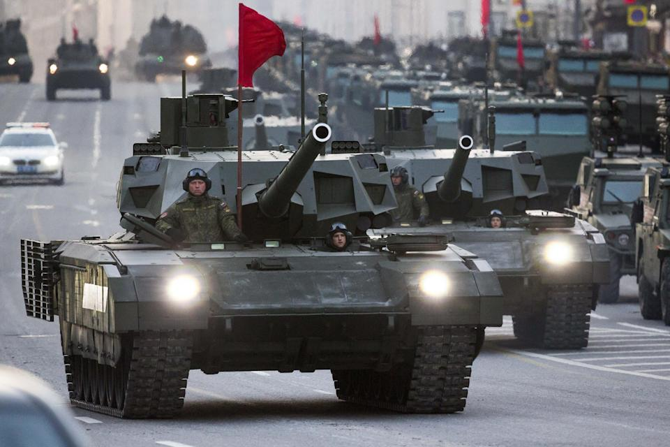 In this photo taken on May  4, 2015, two Russian T-14 Armata tanks make their way to Red Square during a rehearsal for the Victory Day military parade...