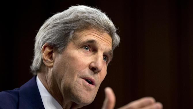 Secretary of State John Kerry testifies on Capitol Hill in Washington, Wednesday, Sept. 17, 2014, during a Senate Foreign Relations Committee hearing on the US strategy to defeat the Islamic State group. (AP Photo/Carolyn Kaster)