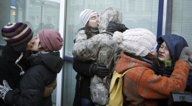 "FILE - In this Wednesday, Dec. 19, 2012 file photo Russian gay right campaigner Pavel Samburov (center left) and five other gay rights activists kiss during a protest near the State Duma, Russia's lower parliament chamber, in Moscow, Russia. A controversial bill banning ""homosexual propaganda"" has been submitted to Russia's lower house of parliament for the first of three hearings Tuesday, Jan. 22. 2013. (AP Photo/Misha Japaridze, file)"