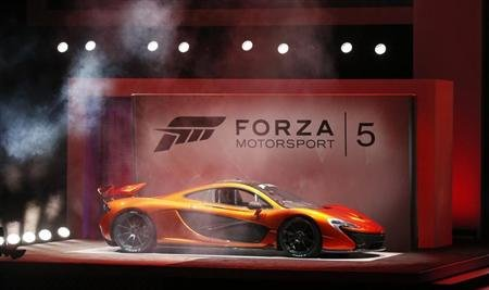 """A McLaren P1 is showcased during a presentation for the game """"Forza Motorsport 5"""" during the Xbox E3 Media Briefing at USC's Galen Center in Los Angeles"""