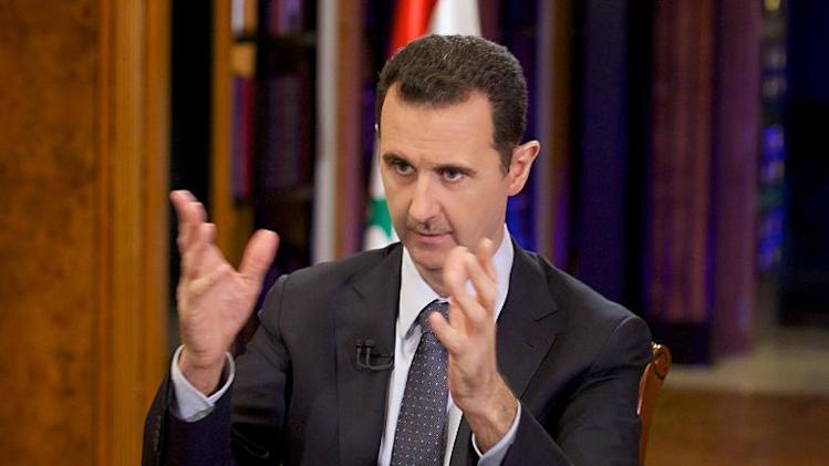 A picture uploaded on the official page of the Syrian Presidency on the internet social network site, Facebook, shows President Bashar al-Assad giving an interview with China's state CCTV in Damascus on September 23, 2013