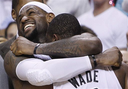 Champs! James' triple-double lifts Heat to title