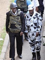 General Bruno Dogbo Ble (L), former commander of the Republican Guard under the regime of former President Laurent Gbagbo, is escorted to his trial in Abidjan October 2, 2012. REUTERS/Luc Gnago
