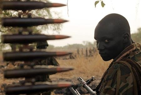 A South Sudan's army, or the SPLA, soldier sits in a truck on the frontline in Panakuach, Unity state on April 24, 2012. REUTERS/Goran Tomasevic