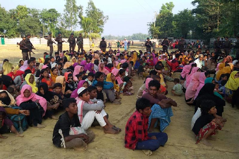 Rohingya Muslims from Myanmar, who tried to cross the Naf river into Bangladesh to escape sectarian violence, are kept under watch by Bangladeshi security officials in Teknaf on December 25, 2016