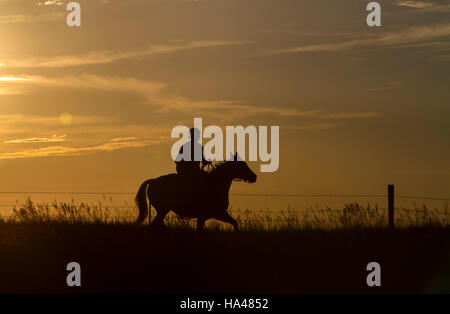 A Native American Sioux Indian On Horseback Crossing A
