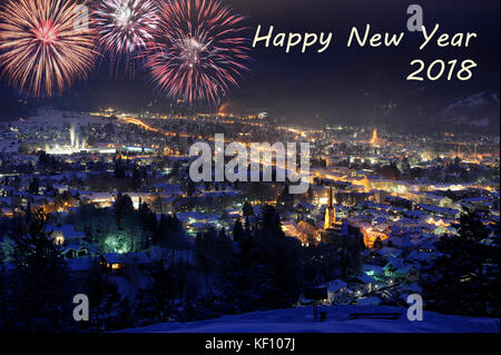 New Year 2018 fireworks in night sky with Chicago cityscape Stock         New Years Eve background  silvester night 2018 with fireworks over city  Garmisch in Bavaria  germany   Stock Photo