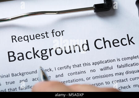 Criminal Background Check Insurance Form Concept Stock Photo         High Angel View Of Criminal Background Check Application Form With Pen    Stock Photo