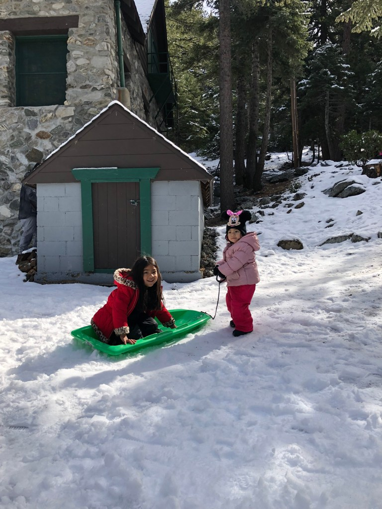 Sisters play in the snow