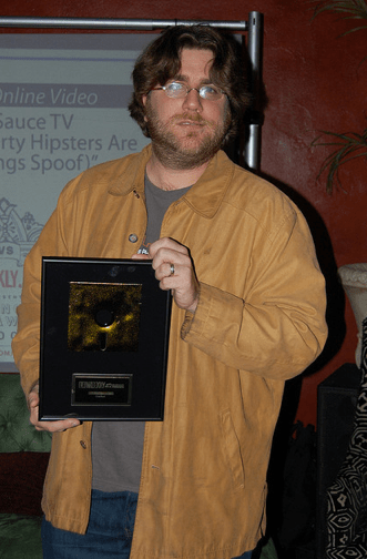 """Me with the """"2009 Activist Website of the Year"""" Award from L.A. Weekly."""